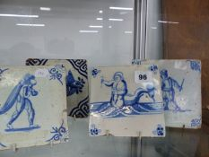 FOUR DELFT BLUE AND WHITE TILES.
