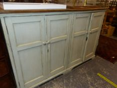 A LARGE VICTORIAN PAINTED PINE AND OAK FOUR DOOR CABINET.