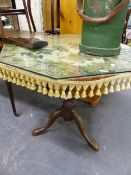 A EARLY 19th C. TRIPOD TABLE WITH OVERLAID TAPESTRY PANEL COVER AND LATER GLASS TOP.