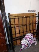 AN ANTIQUE BRASS AND IRON DOUBLE BED.