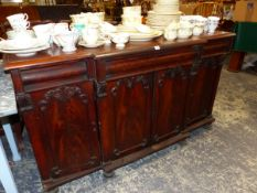 A WILLIAM IV BREAK FRONT MAHOGANY SIDE CABINET.