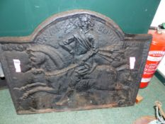 A LARGE CAST IRON FIREBACK WITH HORSE AND RIDER DECORATION BEARING THE DATE 1649 . 68 CM HIGH X 84