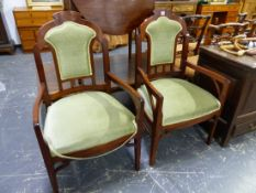 A PAIR OF INTERESTING ARTS MOVEMENT UPHOLSTERED ARM CHAIRS.