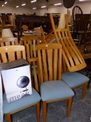 A SET OF TEN MODERN SLAT BACK DINING CHAIRS WITH PADDED SEATS.