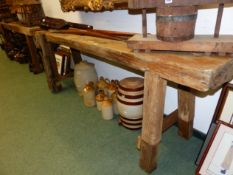 AN ANTIQUE RUSTIC LONG WORKBENCH WITH FITTED VICE 230 X 78 CM HIGH