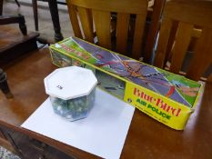 VINTAGE HELICOPTER TOY AND A BOX OF MARBLES.