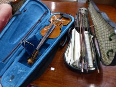 A VINTAGE UNSIGNED VIOLIN IN CASE, A FURTHER CASE AND FIVE BOWS.