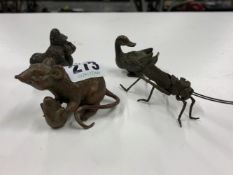 A SMALL CAST FIGURE OF A RAT WITH CORN COB, A GORILLA, A DUCK AND AN ARTICULATED GRASSHOPPER.
