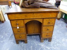 AN EARLY YEW CROSSBANDED WITH OAK PEDESTAL DESK, THE RECTANGULAR LID OPENING ONTO A INSET WRITING