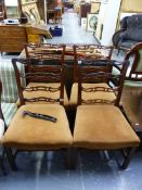 A SET OF FOUR GEORGIAN STYLE MAHOGANY DINING CHAIRS.