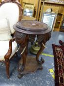 AN ANTIQUE CARVED HARDWOOD EASTERN URN STAND WITH ELEPHANT HEAD SUPPORTS. Dia. 48cm x H. 80cm.