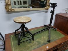 A VINTAGE IRON BASED INDUSTRIAL SWIVEL STOOL AND A SIMILAR STAND/BASE