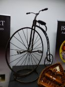 """A VINTAGE IRON """"ORDINARY BICYCLE"""" ( PENNY FARTHING) WITH DISPLAY STAND 108 CM HIGH"""
