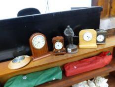 FOUR DESK CLOCKS, A BAROMETER, AND A PETER HICKS SOLDIER FIGURINE.