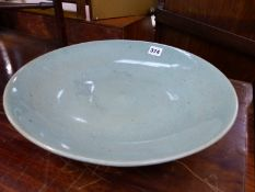 A LARGE 19th C. CHINESE CELADON CRACKLE GLAZE SHALLOW BOWL.