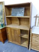 AN ARTS AND CRAFT OAK CABINET WITH SLIDING DOORS.