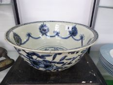 A WANLI BLUE AND WHITE BOWL, THE INTERIOR WITH SWAGS HELD BY ALTERNATING ROSETTES AND RUYI LAPPETS