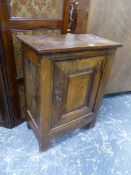 AN ANTIQUE CONTINENTAL OAK PANEL DOOR SMALL SIDE CABINET.