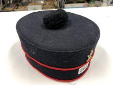 A VINTAGE GURKHA MILITARY DRESS HAT.