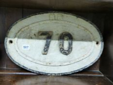 THREE RAILWAY NUMBER SIGNS AND A WOODEN EXAMPLE.