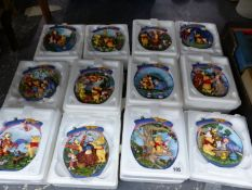 THE BRADFORD EXCHANGE, TWELVE WINNIE THE POOH WALL HANGING LIMITED EDITION PLATES.