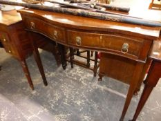 A GEORGIAN STYLE MAHOGANY SERPENTINE SERVING TABLE WITH TWO DRAWERS.