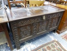 A 18th C. OAK CARVED FRONT COFFER.