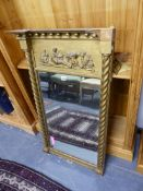 AN ANTIQUE GILT FRAMED PIER MIRROR WITH MOULDED GESSO PANEL.