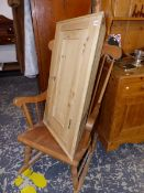 A ROCKING CHAIR AND A PINE CORNER CABINET.