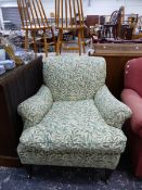 A LATE VICTORIAN HOWARD STYLE DEEP SET ARMCHAIR ON SQUARE TAPER LEGS WITH BRASS CASTORS, AND ANOTHER