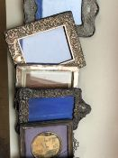 A GROUP OF SIX SILVER FRONTED PHOTOGRAPH FRAMES AND ONE OTHER.