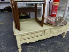 A PAINTED TWO DRAWER LOW COFFEE TABLE WITH CARVED DECORATION, TOGETHER WITH A RETRO NEST OF THREE