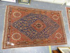 AN ANTIQUE PERSIAN QASHQAI RUG, 194 X 121cms.