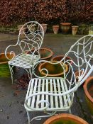 A PAIR OF PATIO CHAIRS