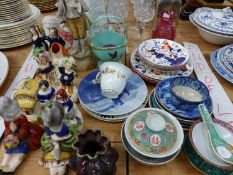 A QUANTITY OF PORCELAIN AND POTTERY FIGURINES, LUSTRE WARES, CUT GLASS, AND OTHER DECORATIVE WARES.
