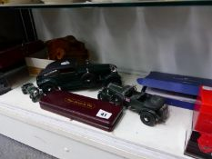 A MINICHAMPS SCALE MODEL BENTLEY, A KYOSHO FERRARI, A MODEL CANNON, DOORKNOBS, OTHER MODEL CARS ,