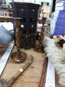 AN EASTERN CARVED WOOD SMALL TABLE, A PAIR OF TURNED WOOD CANDLESTICKS, A CARVED WALKING STICK, A