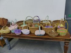 A COLLECTION OF VARIOUS VINTAGE AND LATER HAND FLOWER BASKETS, TRUGS, ETC.