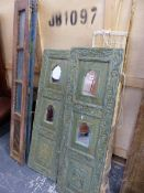A PAIR OF CARVED AND PAINTED EASTERN HARDWOOD PANELS, A PART FOLDING SHUTTER, FOLDING TRESTLES,