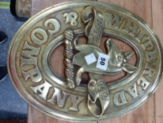 A WHITBREAD AND CO BRASS WALL PLAQUE.