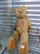 A LARGE VINTAGE TEDDY BEAR.