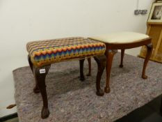 A GEORGIAN STYLE DRESSING STOOL ON CARVED CABRIOLE LEGS TOGETHER WITH A SMALLER PLAIN EXAMPLE.