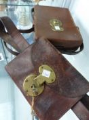 TWO VINTAGE LEATHER POUCHES WITH BRASS LOCKS.