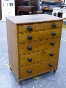 A 19th C. SCUMBLED PINE SMALL CHEST OF FIVE LONG GRADUATED DRAWERS WITH BUN HANDLES, STANDING ON