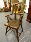 AN ANTIQUE WINDSOR CHAIR WITH FIVE STICK BACK, SADDLE SEAT AND RING TURNED LEGS.