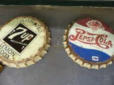 TWO VINTAGE STYLE OVERSIZED PEPSI COLA AND 7UP BOTTLE CAP ADVERTISING SIGNS.