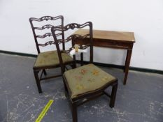 A GEORGE III MAHOGANY SIDE TABLE TOGETHER WITH A PAIR OF ANTIQUE PIERCED LADDER BACK DINING CHAIRS.