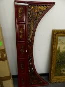 AN ORIENTAL CARVED LACQUERED WOOD ARCHED PANEL.