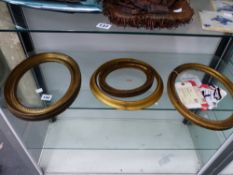 FOUR OVAL PICTURE FRAMES.