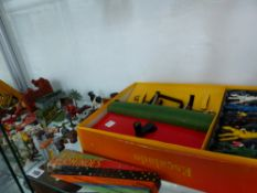 A COLLECTION OF BRITAINS DIE CAST FARM ANIMALS AND VEHICLES AND AN ESCALADO GAME BOXED.